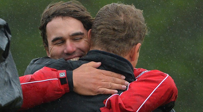 Brooks Koepka hugs caddie Mike Thomson after winning the Scottish Hydro Challenge.