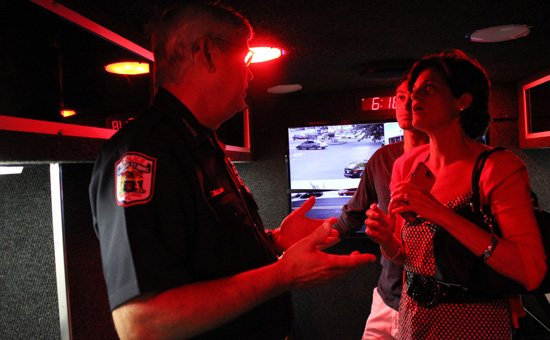 Police Chief Doug Ball offered residents a tour of the city's new mobile command center June 24, showing off its high-tech interior.