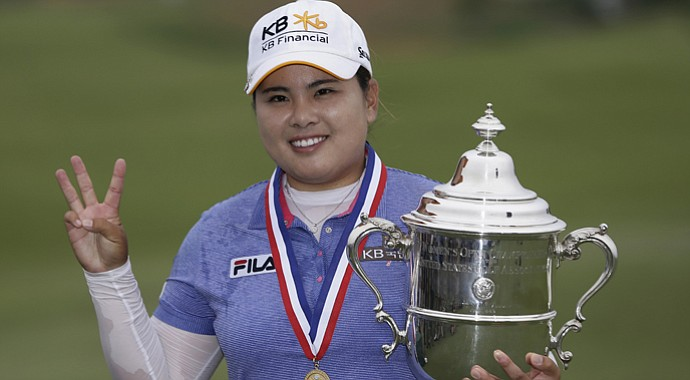 Inbee Park holds up three fingers to represent her three major titles so far this season.