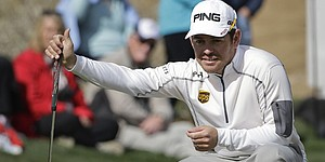 Lewis among leaders in Scotland; Oosthuizen cards 74