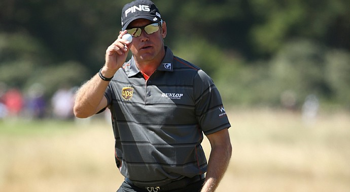 Lee Westwood reacts after making a par putt on the 16th during the second round of the 142nd Open Championship at Muirfield.