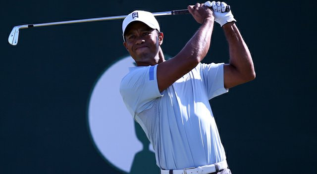 Tiger Woods tees off on the first during the second round of the 2013 Open Championship at Muirfield.