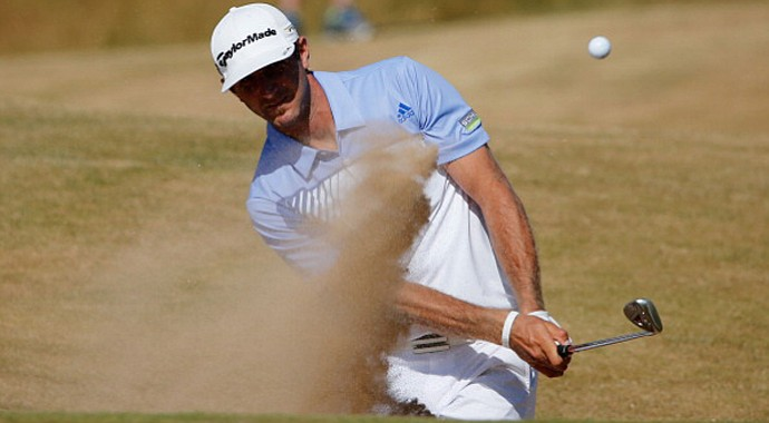 Dustin Johnson plays out of a bunker on the ninth hole during the second round of the Open Championship.