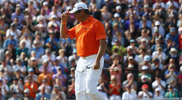 Lee Westwood acknowledges the crowd on the 7th hole during the third round of the 142nd Open Championship at Muirfield.