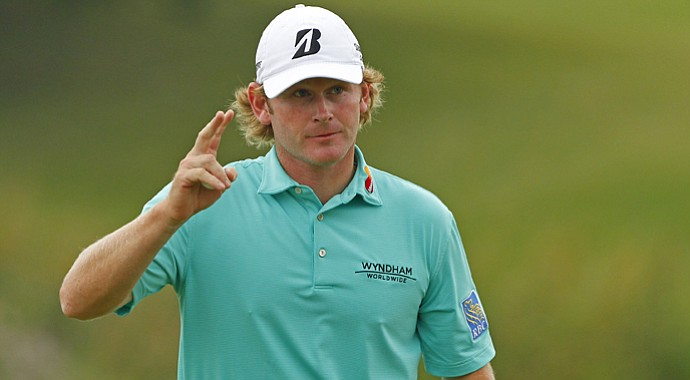 Brandt Snedeker waves to the crowd after finishing his round on the 18th hole during the third round of the RBC Canadian Open.