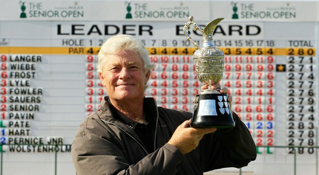 Mark Wiebe poses with the trophy after winning the playoff against Bernhard Langer at the Senior Open Championship at Royal Birkdale.
