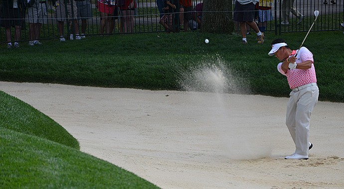 K.J. Choi practices bunker shots prior to the start of the 95th PGA Championship at Oak Hill.