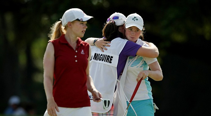 Leona Maguire, far right, hugs sister and caddie Lisa after defeating Stephanie Meadow, left.