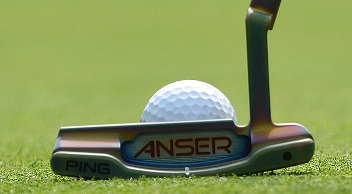 Bubba Watson's Anser Milled 1 putter has a unique copper-colored finish that reflects pink and purple hues in sunlight.