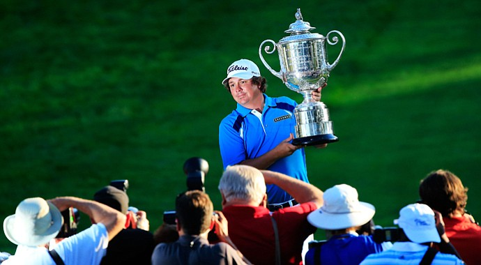 Jason Dufner poses for photographers with the Wanamaker Trophy after his two-stroke victory at the 95th PGA Championship at Oak Hill Country Club.