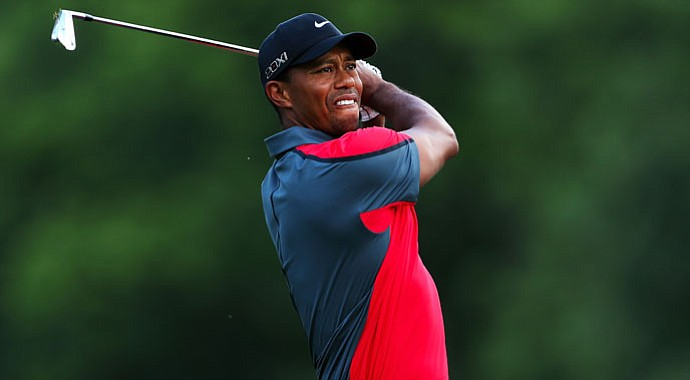 Tiger Woods hits his tee shot on the second hole during the final round of the 95th PGA Championship.