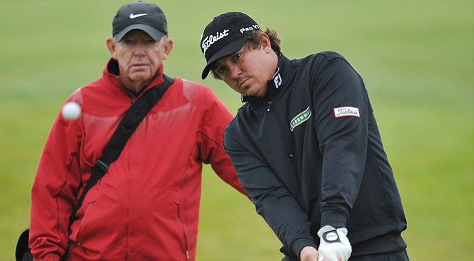 Coach Chuck Cook (left) has elevated student Jason Dufner to major-champion status.