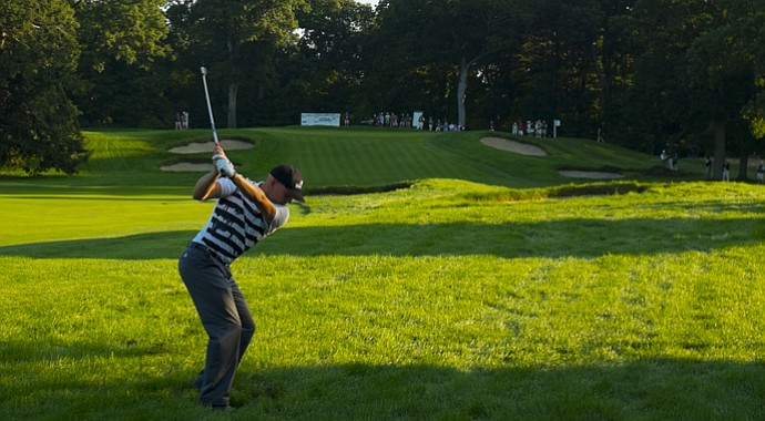Jason Anthony hits a shot during the playoff for the final spots at the 2013 U.S. Amateur.
