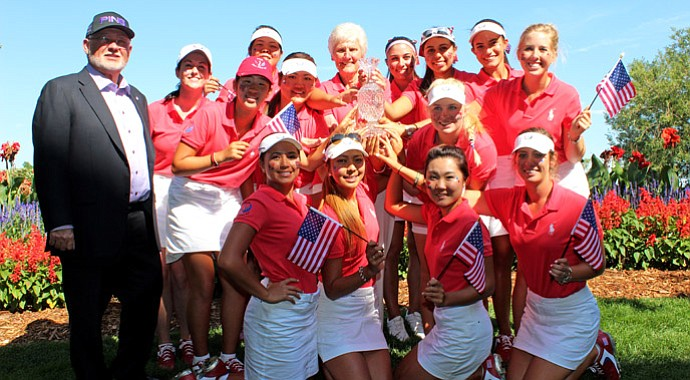 John Solheim (left) celebrates with the winning U.S. squad at the Junior Solheim Cup on Wednesday.