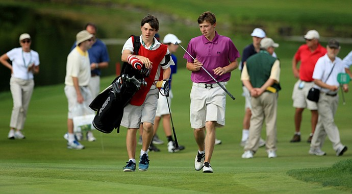 Matthew Fitzpatrick walks up No. 13 with his brother/caddie Alex during the Round of 16 at the 2013 U. S. Amateur at The Country Club.