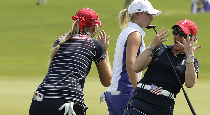 Jessica Korda, left, celebrates with partner Morgan Pressel after the pair put a point on the board for the Americans in Friday foursomes.