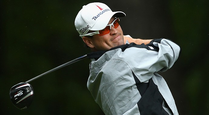 Zach Johnson hits a tee shot on the second hole during the third round of the Wyndham Championship.