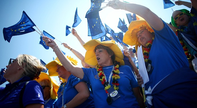 Fans of the European team cheer during the final day singles matches of the 2013 Solheim Cup.