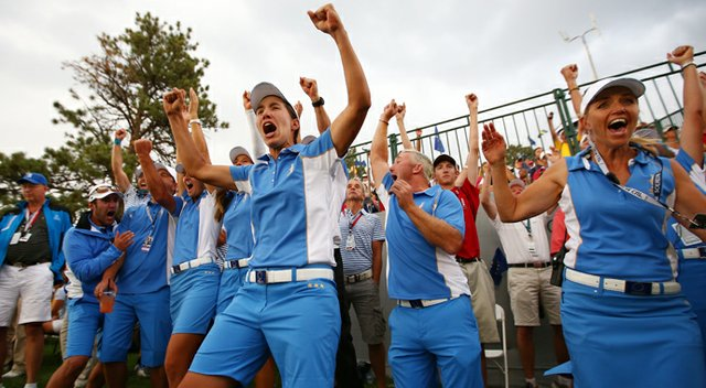 Members of the European team celebrate as they retain the Solheim Cup during the final day singles matches of the 2013 Solheim Cup.