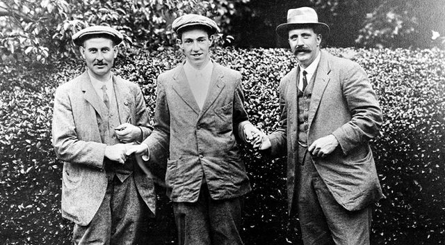 American golfer Francis B. Ouimet, center, shakes hands with Harry Vardon, left, and Ted Ray, both of Britain, at the U.S. Open Golf Championship at The Country Club in Brookline, Mass., in 1913. Ouimet defeated the pair to become the new champion.