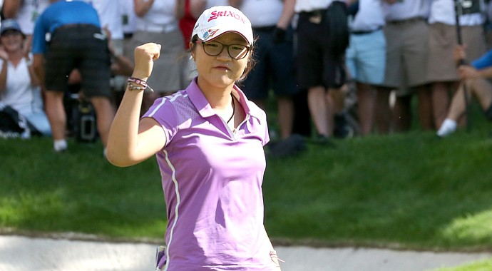 Lydia Ko celebrates after making a birdie putt on the 18th hole to cement her five-stroke victory during the final round of the CN Canadian Women's Open.