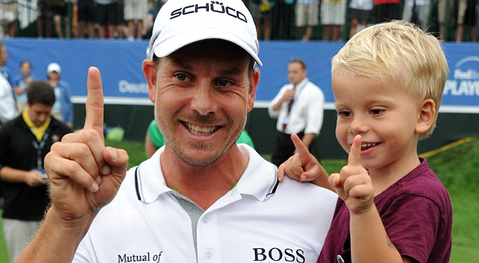 Henrik Stenson celebrates with his son Karl after winning the Deutsche Bank Championship at TPC Boston.