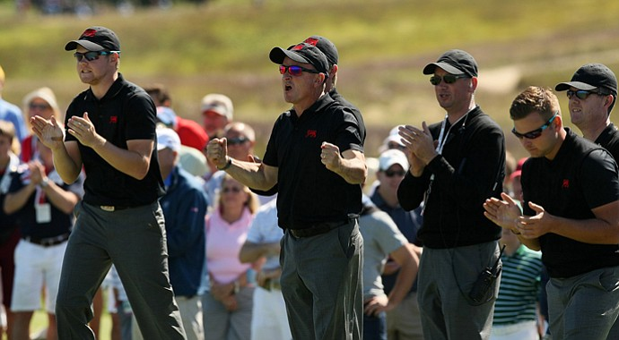 GB&I led by captain Nigel Edwards, center, clap at No. 18 as they gained a point on Saturday of the 2013 Walker Cup at National Golf Links of America in Southampton, N.Y.