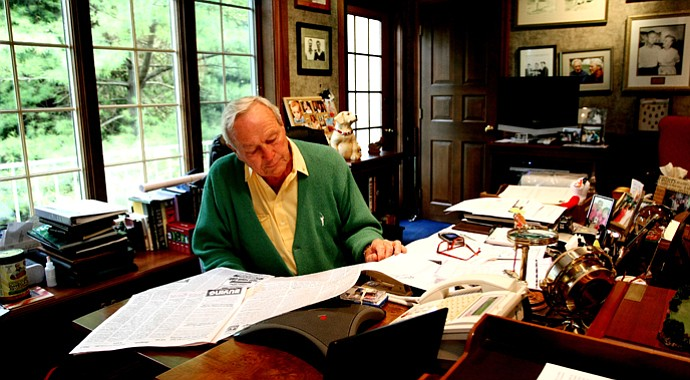 Arnold Palmer reads the newspaper in his office in Latrobe, Pa. prior to his 80th birthday.