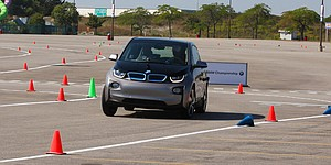 VIDEO: McIlroy, Woodland burn rubber in BMW i3
