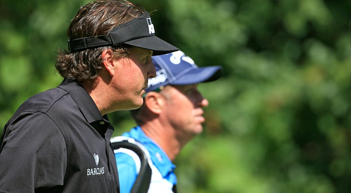 Phil Mickelson walks up the second fairway with caddie Jim Mackay during the first round of the BMW Championship at Conway Farms.