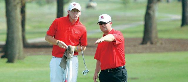 Houston coach Jonathan Dismuke (right) and senior Bryn Flanagan.