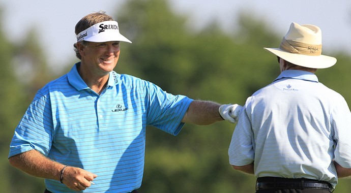 Peter Jacobsen playfully punches Tom Kite in the arm during the 2012 U.S. Senior Open.