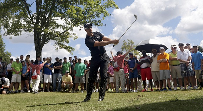 Henrik Stenson hits out of the rough on the first hole during the final round of play in the Tour Championship.