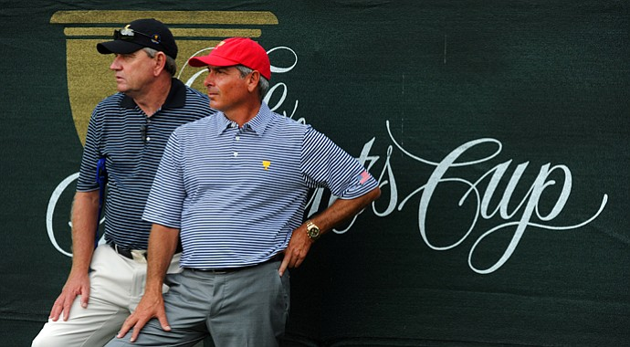 Nick Price, captain of the International team, and Fred Couples, captain of the U.S. team, watch the action on 7th hole during the Day 2 foursome matches at Muirfield Village.