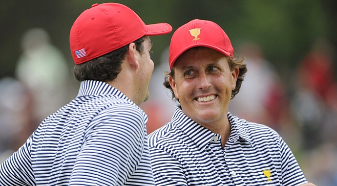 Phil Mickelson of the U.S. smiles at teammate Keegan Bradley during the Day 2 foursomes matches at the Presidents Cup.