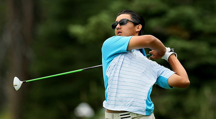 Zecheng Dou hits a shot during the U.S. Junior Amateur.