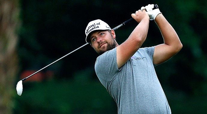 Ryan Moore won the CIMB Classic in a playoff with Gary Woodland.
