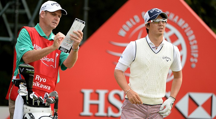 Ryo Ishikawa with caddie Simon Clarke at the HSBC Champions on Thursday.