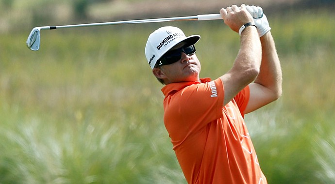 Brian Gay shot a 7-under 63 to share the lead with Briny Baird at the fog-delayed McGladrey Classic.