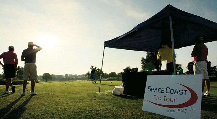 Golfers tee off during a Space Coast Tour event at Reunion Resort.