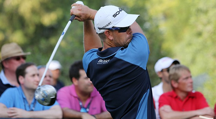 Henrik Stenson tees off on the 16th hole during the first round of DP World Golf Championship in Dubai.