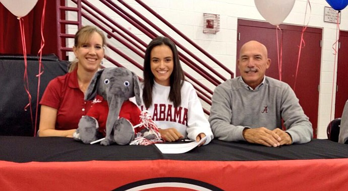 Nicole Morales (center) signs with Alabama.