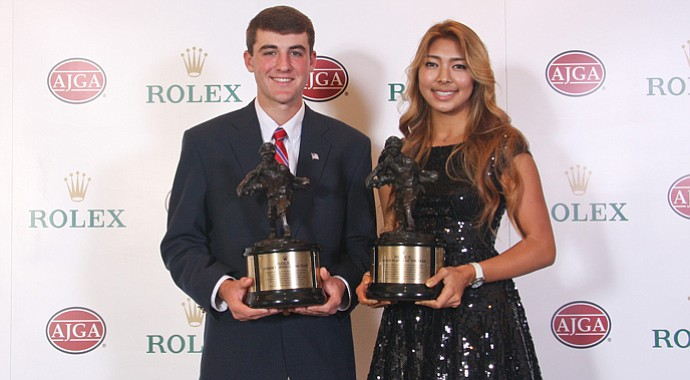 Scottie Scheffler and Alison Lee with their AJGA Rolex Player of the Year trophies.