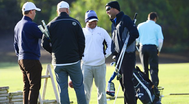Harry Arnett (left) and Jason Finley (right) of Callaway chat with the team from Cobra, including Jose Miraflor (middle), on the practice range prior to the start of the final round at the Industry Cup in Irvine, Calif.