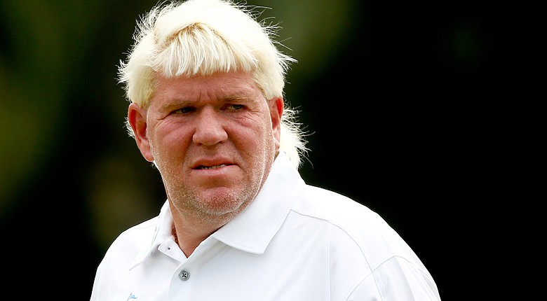 John Daly made the cut at the Sony Open, but says he reinjured his surgically repaired elbow during a bunker shot on the 12th hole.