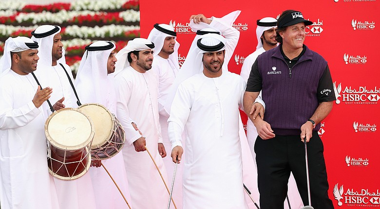 Phil Mickelson with local dancers during a photo call prior to the start of the Abu Dhabi HSBC Championship.