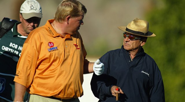 John Daly chats with actor Joe Pesci during the second round of the Bob Hope Chrysler Classic on January 30, 2003.