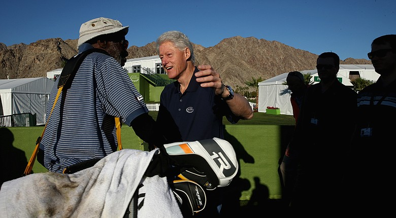 Former U.S. President Bill Clinton greets attendants of the Humana Challenge in partnership with the Clinton Foundation before the first round at PGA West in La Quinta, California.
