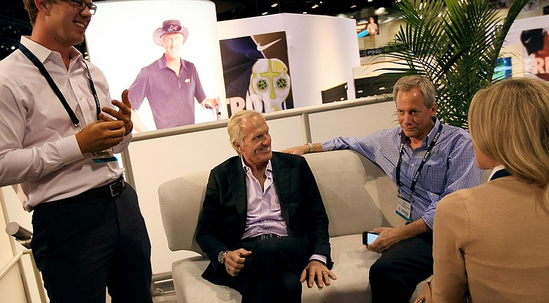 Greg Norman in the Cobra-Puma booth at the 2014 PGA Merchandise Show in Orlando, Fla.