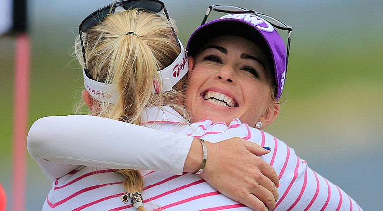 Paula Creamer (right) hugs Jessica Korda after finishing play on the 18th green during Round 2 of the Pure Silk Bahamas LPGA Classic.